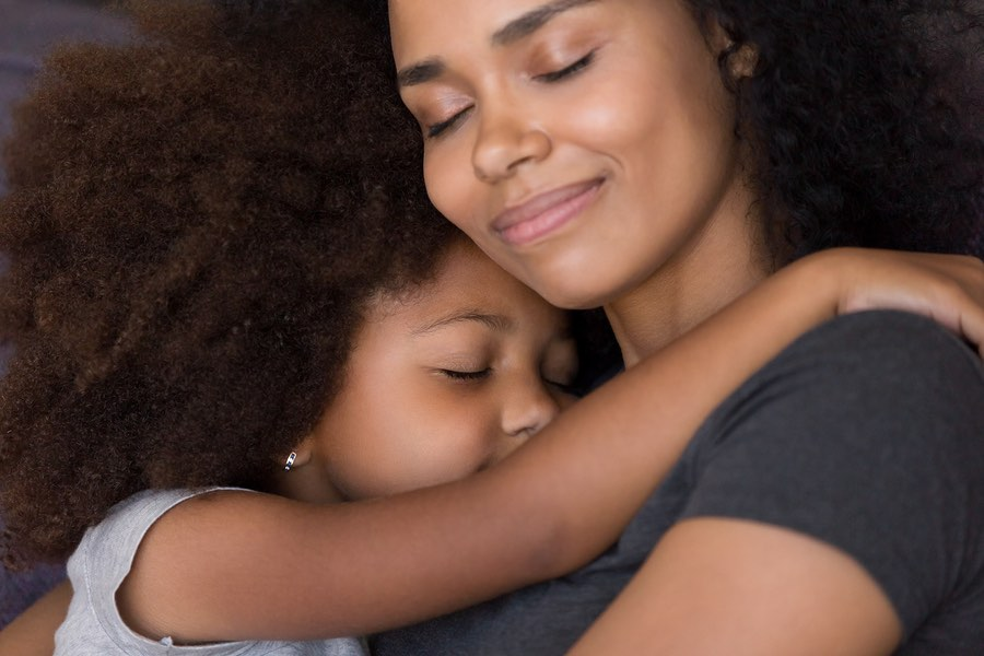 Loving Single Black Mother Hugs Cute Daughter Feel Tenderness Connection